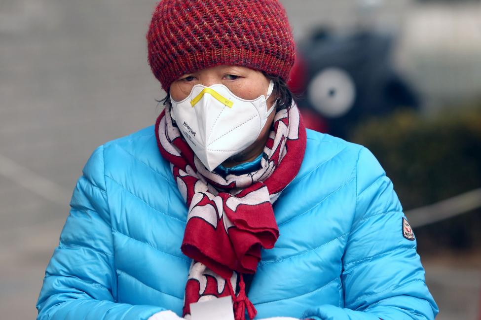 A Chinese woman wears a protective face mask at a shopping center due to the threat of the spreading deadly coronavirus in Beijing. Photo by Stephen Shaver/UPI